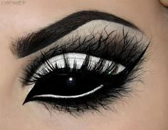 Impressive and Striking Halloween Makeup Art by Kiki. Look at that solid black contact lens.