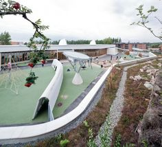 House of Children in Saunalahti, Finland.  Playground forms a safe, unobstructed and exhilarating artificial landscape. Motives, materials and colours of the building have been inspired by the existing landscape.