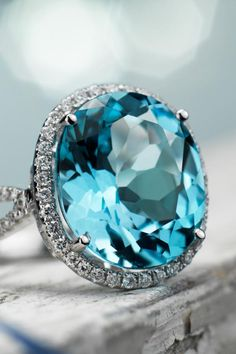 "I love this stunning blue topaz and diamond cocktail ring from Blue Nile....for my ""something blue"" perhaps?"