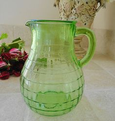 This Anchor Hocking Depression Glass Block Option Pitcher is similar to the green pitcher in which Maggie served lemonade.