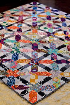 Beautiful quilt with links to dimensions and easy instructions. Could easily make it color coordinated.