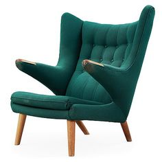 A Hans J Wegner Papa Bear easy chair, AP-stolen, Denmark. Upholstered with a green fabric, oak legs and paws.. - The Spring Contemporary, Stockholm 573 – Bukowskis