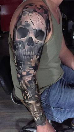 Skull inspired sleeve tattoo. The grayscale themed tattoo makes the design look mysterious and fearless. Below is a puzzle like design that combines to form a girl's face.