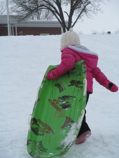 Granddaughter using her Dad's old Ninja turtle Sled