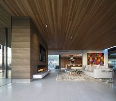 Love the rammed earth fire place. Rammed Earth House by Brent Kendle: This modern single story hillside home designed by Brent Kendle is located in Paradise Valley, Arizona. Rammed Earth Homes, Rammed Earth Wall, Ceiling Decor, Ceiling Design, Ceiling Fixtures, Modern Interior Design, Interior Architecture, Haus Am Hang, Plafond Design