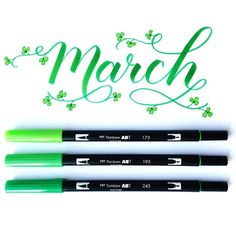 March calendar idea, brush lettering with Tombow pens in green with shamrocks and flourishes