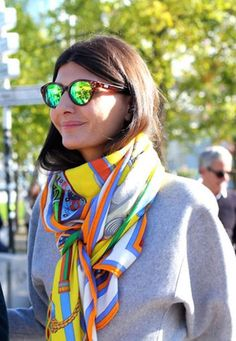 I love, love, love silk scarves. I like framing them on my walls, wrapping them around my neck, tying them on my handbag, and even fashioning them into a top in warm weather. I have a small collection
