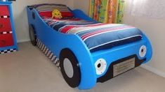 Introduction Section Section Introduction This is a compact race car bed and is a good size for kids up to the age of 8 or so. It does not take up nearly as much room as a standard single bed, so it is ideal for a room where… Kids Car Bed, Race Car Bed, Easy Diys For Kids, Wooden Pallet Projects, Pallet Ideas, Diy Projects, Bed Plans, Table Plans, Blue Bedding