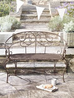 Add a touch of French inspiration to your indoor or outdoor space with our Elegant Metal Bench. Crafted from strong, weighty metal with a vintage distressed finish, this simple two-seater bench has smooth scroll details and a rustic taupe finish. Designed to match our Elegant Metal Furniture Collection, this elegant bench looks perfect sat under your porch or in your garden room.