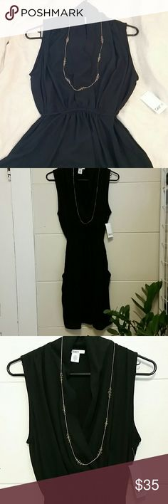 LBD with POCKETS , Very Flattering, Large, NWT This is a piece I outgrew before I had the chance to wear it! It has a deep V-neck and REAL pockets!! Yay pockets! It ties in the back at the waist, is lined and in Perfect Condition! Bar III Dresses Midi