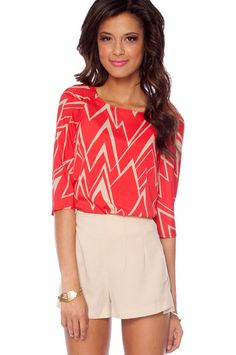 Red and beige zig-zag top with beige shorts. I loooove this!  May need my shorts a little longer :)