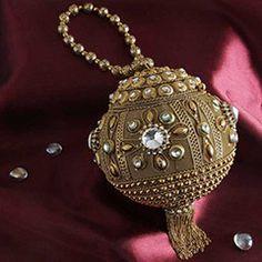 Ball Shaped Golden Clutch @ http://www.rakhibazaar.com/return-gifts-to-sisters-101.html
