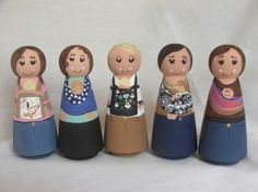 Adorable Safe Babywearing dolls demonstrating safe positioning in different kinds of ergonomic baby carriers.