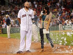 Jonny Gomes was doused by a teammate after the Red Sox win. Jenny Dell caught some, too!