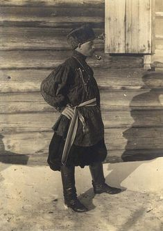 Festive costume of gold seeker.  The picture was taken in the village of Boguchany in 1911 Photo portrait of a young man dressed in a festive gold seeker crafts.