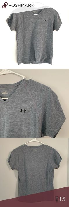 Under Armour Tee Gray Short Sleeve Vneck Athletic Gray tee by Under Armour with a Vneck. Under Armour Logo on the chest of the shirt.  No flaws noticed upon inspection.  LS41  Add to a bundle of 3 or more items to receive this item for free! Under Armour Tops Tees - Short Sleeve