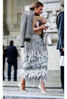 28ff964c8 Rhythm: The different layers of fringe/feathers throughout this skirt  create rhythm for this piece. The designer uses color and texture to  achieve this ...
