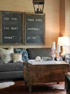 Love the handmade artwork with barn wood frames, cowhide rugs and a vintage trunk.