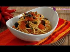 Spaghetti puttanesca - original Italian recipe, an easy Italian recipe for a tasty first course simply made with tomato, anchovy, capers and olives