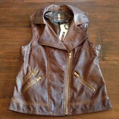 Hot Vegan Leather Moto Vest This faux leather motorcycle vest has been dyed to really look like worn leather - best treatment of faux leather I personally have ever seen. Antique gold zippers. Brand new with tags. Buffalo Tops
