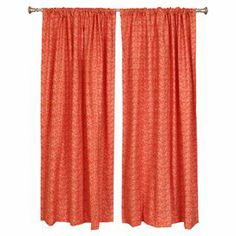 "The textured-look chevrons in tangelo of this pair of cotton curtains dress your windows with sunny appeal.   Product: Set of 2 curtain panelsConstruction Material: CottonColor: TangeloFeatures:  2"" Rod pocket3"" HemMade in the USA  Note: Rod not includedCleaning and Care: Spot clean"