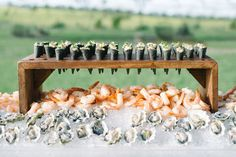 20 Raw Bars Perfect for Your Summer Wedding This year a wedding trend has been a raw bar with oysters, sushi, and shrimp. We have combines 20 raw bar inspirational food ideas for your wedding day. Your guests will love this cool reception appetizer! Wedding Catering Near Me, Wedding Reception Food, Wedding Blog, Wedding Venues, Wedding Food Displays, Wedding Food Bar Ideas, Unique Wedding Food, Wedding Foods, Gown Wedding
