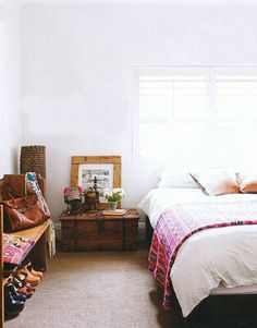 I like the idea of having an entryway bench in a master bedroom. Cute place to store shoes and purses