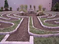 Davenport Indoor Temporary Garden Labyrinth National Trails Symposium.  The 40-foot, 5-circuit pattern was designed by Jeff Saward, internationally renowned labyrinth scholar, creator, and curator of Labyrinthos: The Labyrinth Resource Centre and Photo Library and Archive.