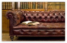 Rolled arm, button-tufted leather Chesterfield -- aged to perfection.