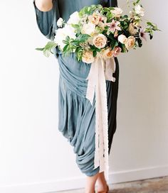 Beauty in a gorgeous draped @freepeople dress. | model @brenna.beth | photo by @ciara_richardson_photo