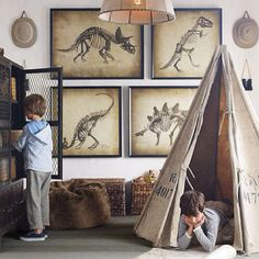 Boy's playroom.  Love the framed dinosaurs!!!