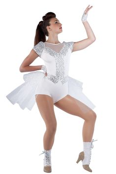 15345 Yoncé | Tap Jazz Funk Dance Costumes | Dansco 2015 | White spandex leotard with white glitter mesh inserts, silver sequin on white spandex overlay and foam lined sleeves. Separate glitter printed white tulle and white net bustle. Gloves, boot covers and ribbon for lacing included.