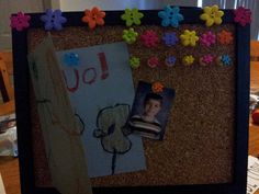 Personal Cork Board for a teacher gift.  Purchase a cheap wooden frame, decorate with buttons, add button push-pins (wood tacks work best), put cork board in the frame and remove glass. Attach a school picture and have your child make a homemade card!    Hot glue worked great for this project!