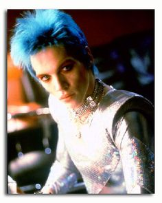 Brian Slade. Fictional character from the movie Velvet Goldmine, loosely based on David Bowie.