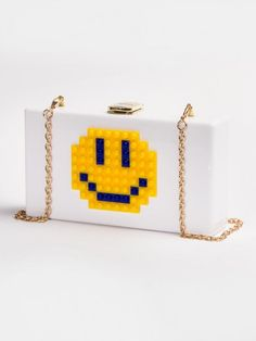 Emoji Clothes, Sweatpants, Tops, Bags, and Jewelry - Emoji Clutch in White, $48; at Kitson