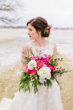 """I wanted a beautifully """"messy"""" bouquet which included pink and white peonies as the focal point. It was styled by Birdie Blooms with local Colorado wild flowers, adding in pine and berries to give it a winter feel."""