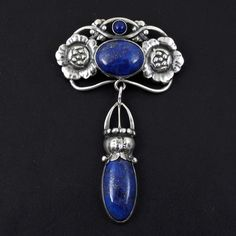 Georg Jensen brooch or pin; sterling silver Art Nouveau dangle with lapis lazuli. Vintage Silver Jewelry, Sterling Silver Jewelry, Antique Jewelry, Silver Jewellery, Art Nouveau Jewelry, Jewelry Art, Jewelry Design, Lapis Lazuli Jewelry, Silver Work