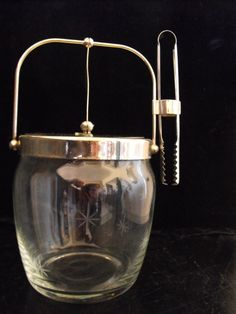 Vintage atomic glass ice bucket and tongs.. $20.00, via Etsy.