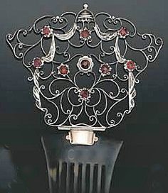 A tortoiseshell comb with intricate scrollwork and garnets by British arts-and-crafts movement master-jeweler Child & Child, with makers mark on the back and fitted case, sold for $691 in London.