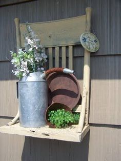 Creative Yard Display~ Paint the top of an old chair, remove the legs (or maybe the legs were broken) and hang it outside to create a great flower garden shelf display. This is really cool!
