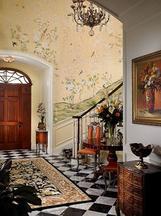 Gorgeous entrance way with elegant oriental carpet and wallpaper. Nantucket RI