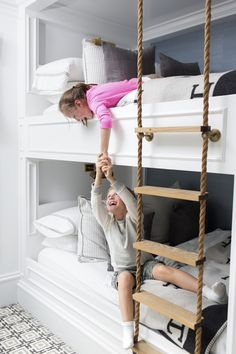 Great bunk bed built-in.  Love the clever rope ladder here!  It is so fantastic to see people thinking creatively and outside of the box!  Great idea.