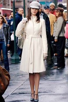 From The Devil Wears Prada: Ivory Angora Coat, Yigal Azrouel Gold Python Hobo Bag, Calvin Klein Hat and Gloves, Chanel Strappy Shoes, Marni