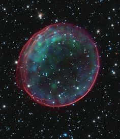 Four hundred years ago a star exploded as a type 1a supernova in the Large Magellanic Cloud (LMC) some 170,000 light-years from Earth. This is what was left behind. The beautiful ring-like structure of supernova remnant (SNR) 0509-67.5 is highlighted by Hubble and NASA's Chandra X-ray space observatory observations. The X-ray data (blue/green hues) are caused by the shockwave of the supernova heating ambient gases. Image courtesy of NASA, ESA, CXC, SAO, the Hubble Heritage Team…