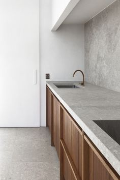 Wooden cabinets, concrete countertops and backsplash, grey kitchen, white