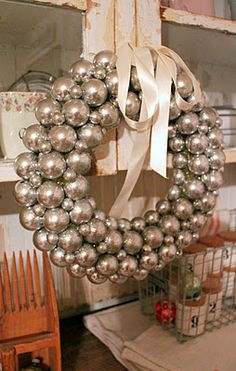 I want one of these ornament wreaths above our mantle