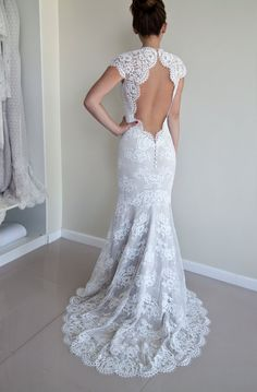 Lace wedding dress with scalloped keyhole back, illusion neckline and 3/4 sleeves in trumpet silhouette and built in bra cups  The wedding dress is