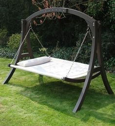 its a hammock, no its a swing, no its a bed! . Either way, I need this!!!