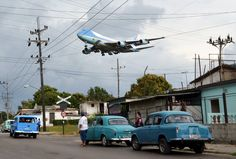 Air Force One carrying U.S. President Barack Obama and his family flies over a neighborhood of Havana as it approaches the runway to land at Havana's international airport on March 20.