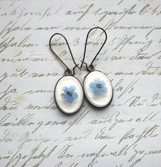 Forget me nots in resin. $22 from NaturalPrettyThings on Etsy